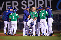 Tulsa Drillers pinch hitter Chase De Jong (34) is mobbed by teammates as Lars Anderson celebrates after a walk off bunt due to an error during a game against the Arkansas Travelers on April 28, 2016 at ONEOK Field in Tulsa, Oklahoma.  Tulsa defeated Arkansas 5-4.  (Mike Janes/Four Seam Images)