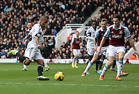 Pictured L-R: Wayne Routledge of Swansea attempts to cross the ball over Stewart Downing. 01 February 2014<br /> Re: Barclay's Premier League, West Ham United v Swansea City FC at Boleyn Ground, London.