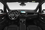Stock photo of straight dashboard view of a 2018 BMW 2 Series 225xe iperformance 5 Door Mini Van