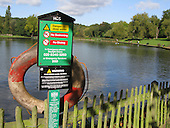 Life Buoy and Warning Sign at Hampstead Heath Pond, London
