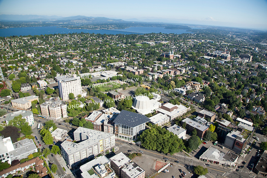 aerial photo of Seattle's Bullitt Center, the greenest commercial building in the world, with the Capitol Hill neighborhood, Lake Washington, and Mount Rainier beyond