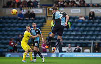Garry Thompson of Wycombe Wanderers heads towards goal during the Sky Bet League 2 match between Wycombe Wanderers and Oxford United at Adams Park, High Wycombe, England on 19 December 2015. Photo by Andy Rowland.