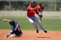 Boston Red Sox shortstop Deven Marrero #7 turns a double play as Michael Kvasnicka #9 slides in during a minor league Spring Training game against the Minnesota Twins at JetBlue Park Training Complex on March 27, 2013 in Fort Myers, Florida.  (Mike Janes/Four Seam Images)