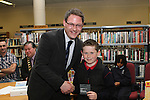 4th Class Student at Whitecross NS, Conor Kelly receives his runner up prize from Editor of the Drogheda Leader, Gordon Hatch at the Drogheda Counts Presentation in Drogheda Library...(Photo credit should read Jenny Matthews/NEWSFILE)...