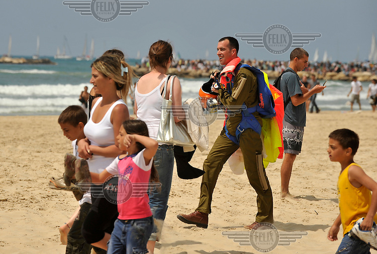 An Israeli army paratrooper after landing on a beach in Tel Aviv during a military show celebrating the 60th anniversary of the State of Israel..