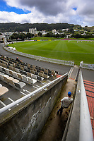 Hamish Rutherford watches from the RA Vance Stand player's entrance after being run out on day one of the Plunket Shield cricket match between the Wellington Firebirds and Otago Volts at Basin Reserve in Wellington, New Zealand on Monday, 21 October 2019. Photo: Dave Lintott / lintottphoto.co.nz