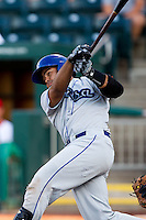 Wilin Rosario (20) of the Tulsa Drillers follows through his swing during a game against the Springfield Cardinals at Hammons Field on July 19, 2011 in Springfield, Missouri. Tulsa defeated Springfield 17-11. (David Welker / Four Seam Images)