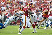 Landover, MD - September 16, 2018: Washington Redskins running back Adrian Peterson (26) avoids the tackle by Indianapolis Colts linebacker Darius Leonard (53) during the  game between Indianapolis Colts and Washington Redskins at FedEx Field in Landover, MD.   (Photo by Elliott Brown/Media Images International)