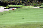 A red flag marking the hole on a golf course during the fall season in Branson Missouri