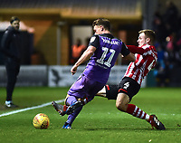 Port Vale's Luke Hannant is tackled by  Lincoln City's Michael O'Connor<br /> <br /> Photographer Andrew Vaughan/CameraSport<br /> <br /> The EFL Sky Bet League Two - Lincoln City v Port Vale - Tuesday 1st January 2019 - Sincil Bank - Lincoln<br /> <br /> World Copyright © 2019 CameraSport. All rights reserved. 43 Linden Ave. Countesthorpe. Leicester. England. LE8 5PG - Tel: +44 (0) 116 277 4147 - admin@camerasport.com - www.camerasport.com