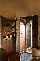 The restored kitchen of a palazzo apartment in the medieval village of Santo Stefano di Sessani in the Abruzzo region of Italy