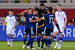 Tsukasa Shiotani of Japan celebrates scoring the team's second goal with teammates during the AFC Asian Cup UAE 2019 Group F match between Japan (JPN) and Uzbekistan (UZB) at Khalifa Bin Zayed Stadium on 17 January 2019 in Al Ain, United Arab Emirates. Photo by Marcio Rodrigo Machado / Power Sport Images