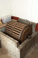 an old wooden washing machine , Bodegas Otero, Benavente spain castile and leon