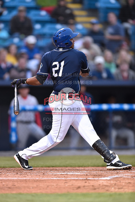 Asheville Tourists first baseman Henry Garcia (21) swings at a pitch during a game against the Greenville Drive on April 16, 2015 in Asheville, North Carolina. The Tourists defeated the Drive 5-4. (Tony Farlow/Four Seam Images)