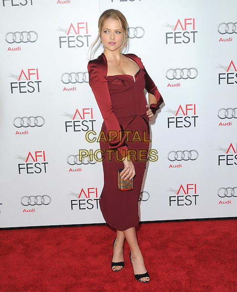 """Teresa Palmer.Attending AFI FEST 2012 """"Lincoln"""" Closing Night Gala Screening held at Grauman's Chinese Theatre, Hollywood, California, USA, 8th November 2012. .full length burgundy dress long sleeve shrug cut out sleeves hand on hip red black shoes open toe gold clutch bag .CAP/DVS.©Debbie VanStory/Capital Pictures."""