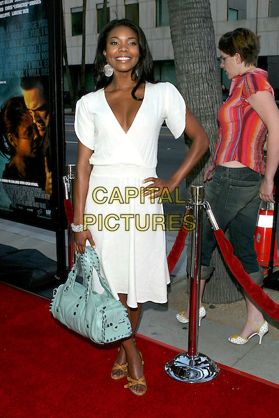 "GABRIELLE UNION.The Los Angeles Premiere of ""Crash"" held at The Academy of Motion Picture Arts and Sciences, Beverly Hills, California, USA, 26 April 2005..full length white cream wrap around dress pose hand on hip bracelet bangle turquoise green bag.Ref: ADM.www.capitalpictures.com.sales@capitalpictures.com.©Jacqui Wong/AdMedia/Capital Pictures."