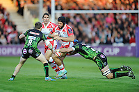 Gareth Evans of Gloucester Rugby is tackled by Will Chudley and Dean Mumm of Exeter Chiefs during the European Rugby Challenge Cup semi final match between Gloucester Rugby and Exeter Chiefs at Kingsholm Stadium on Saturday 18th April 2015 (Photo by Rob Munro)