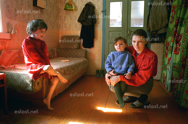 Belarus/Weissrussland, 2005<br /> KUZKAVITCHI. Elena Kosiakova (26), mother of three children is living in the village of Kuskavitchi some 20 km from the small town Bykhov in the Mogilev region (Belarus). This region was heavily contaminated by radioactive fallout after the Chernobyl disaster. The village Kuskavitchi was contaminated up to 15 Curie per square kilometer. According to Western standards this village should be evacuated immediately. Elena lives of some 220 000 Belorussian rubles (100 US dollars) per month, which she gets from the social services of the government. Despite of the lack of money she has adopted two more children, because their parents were not able to provide for them.<br /> ? Vaclav Vasku/EST&amp;OST