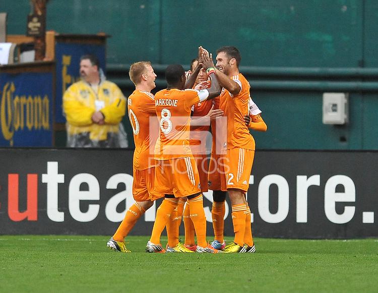 Will Bruin (12) of the Houston Dynamo celebrates his score with teammates in the 16th minute of the game. The Houston Dynamo defeated D.C. United 4-0, at RFK Stadium, Wednesday May 8 , 2013.