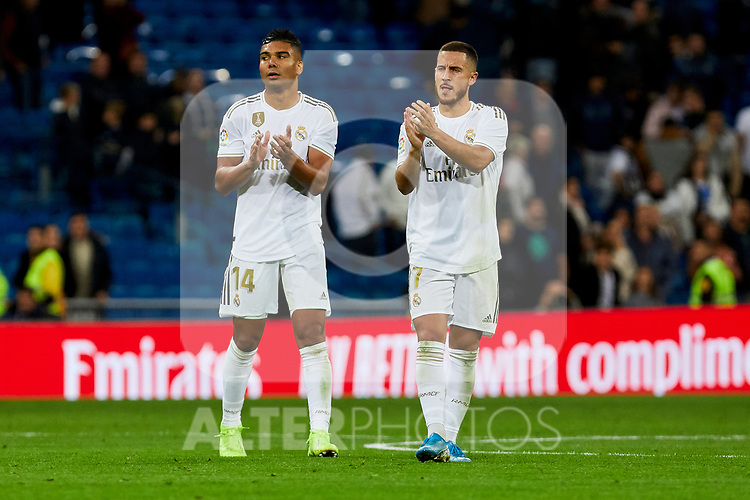 Eden Hazard (R) and Carlos Henrique Casimiro (L) of Real Madrid celebrate the victory after La Liga match between Real Madrid and CD Leganes at Santiago Bernabeu Stadium in Madrid, Spain. October 30, 2019. (ALTERPHOTOS/A. Perez Meca)