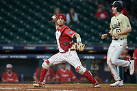 Kyle Lovelace (34) of the Houston Cougars makes a throw to first base against the Vanderbilt Commodores during game nine of the 2018 Shriners Hospitals for Children College Classic at Minute Maid Park on March 3, 2018 in Houston, Texas. The Commodores defeated the Cougars 9-4. (Brian Westerholt/Four Seam Images)