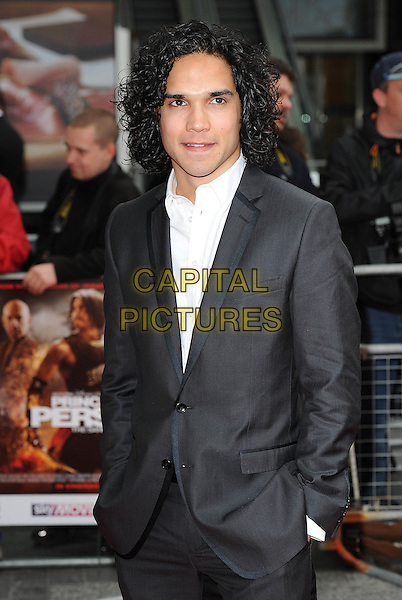 "REECE RITCHIE.The World Premiere of ""Prince Of Persia - Sands Of Time"", The Vue Westfield, London, England..9th May 2010.half length hands in pocket suit jacket white grey gray . CAP/BEL.©Tom Belcher/Capital Pictures."