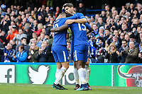 Alvaro Morata of Chelsea (centre) celebrates with Eden Hazard of Chelsea (left) and Victor Moses of Chelsea (right) after he scores his team's second goal of the game to make the score 2-1 during the Premier League match between Chelsea and Newcastle United at Stamford Bridge, London, England on 2 December 2017. Photo by David Horn.