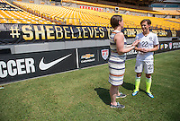 Pittsburg, PA - August 15, 2015:  Meghan Klingenberg talks with Marty's Market owner, Regina Koetters, during a She Believes event at Heinz Field.
