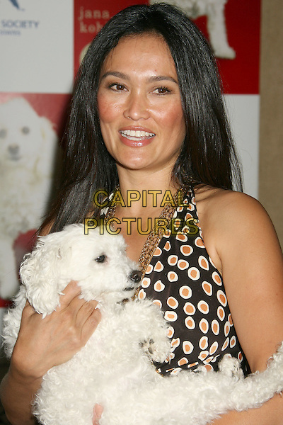"TIA CARRERE.""A Rare Breed of Love"" Release Party held at the Beverly Hills Hotel, Beverly Hills, California, USA, .29 May 2008..half length holding dog pet.CAP/ADM/MJ.©Michael Jade/Admedia/Capital Pictures"