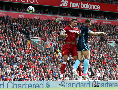 May 21st 2017, Anfield, Liverpool, Merseyside; EPL Premier league football, Liverpool versus Middlesbrough; Rudy Gestede of Middlesbrough out jumps Joel Matip of Liverpool to head the ball at goal