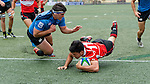 Players in action during the Day 1 of the IRB Junior World Rugby Trophy 2014 at the Hong Kong Football Club on April 07, 2014 in Hong Kong, China. Photo by Chung Yan / Power Sport Images