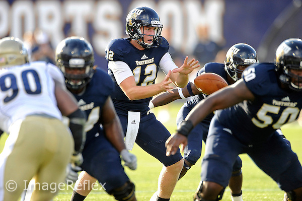 8 September 2012:  FIU quarterback Jake Medlock (12) takes the snap in the first quarter as the FIU Golden Panthers defeated the Akron Zips, 41-38 (overtime), at FIU Stadium in Miami, Florida.