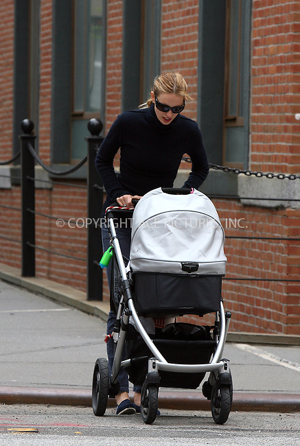 WWW.ACEPIXS.COM . . . . .  ....Exclusive - All rounder....April 13 2010, New York City....Victoria's Secret model Karolina Kurkova seen walking with her baby in her Tribeca neighborhood on April 13 2010 in New York City....Please byline: PHILIP VAUGHAN - ACE PICTURES.... *** ***..Ace Pictures, Inc:  ..Philip Vaughan (212) 243-8787 or (646) 679 0430..e-mail: info@acepixs.com..web: http://www.acepixs.com