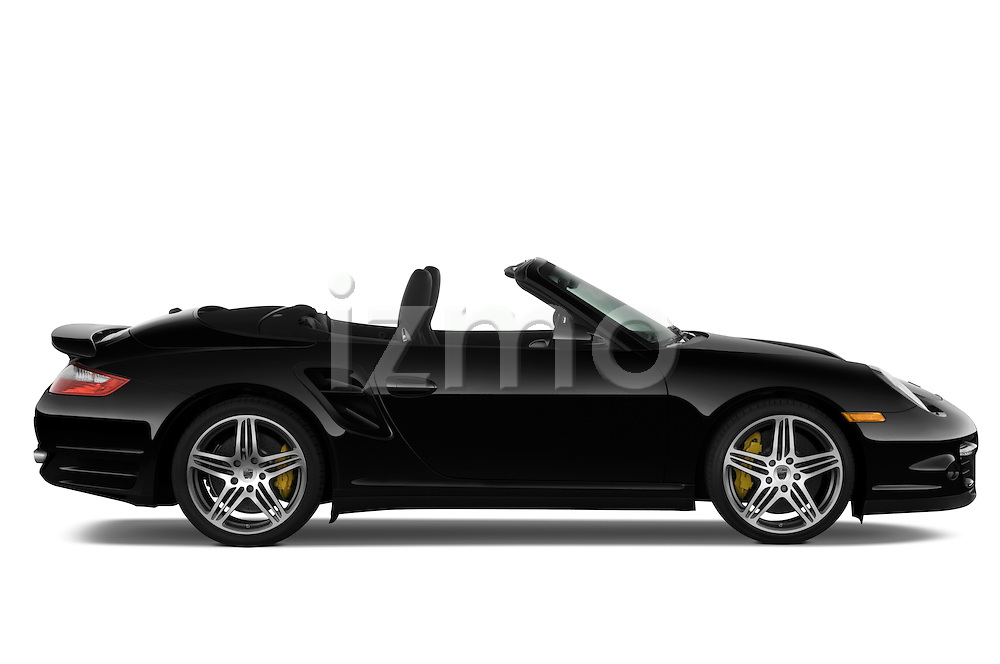 Passenger side profile view of a 2009 Porsche Carrera Turbo, with top down..