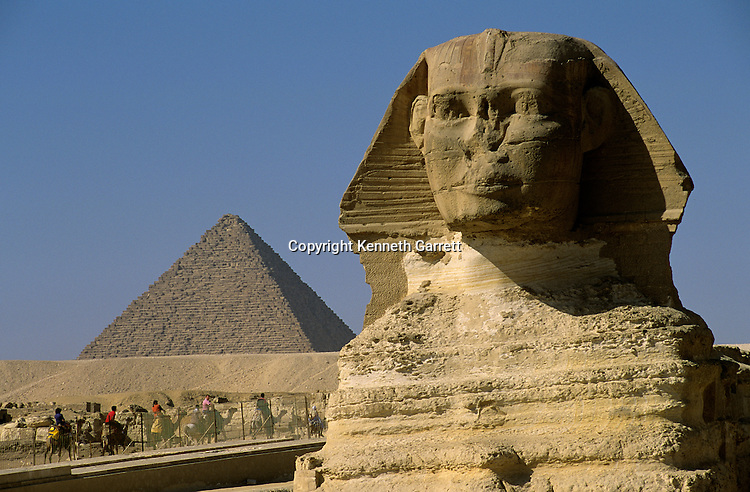 The Sphinx with 4th dynasty Pharaoh Menkaure's pyramid in background; Giza; Egypt