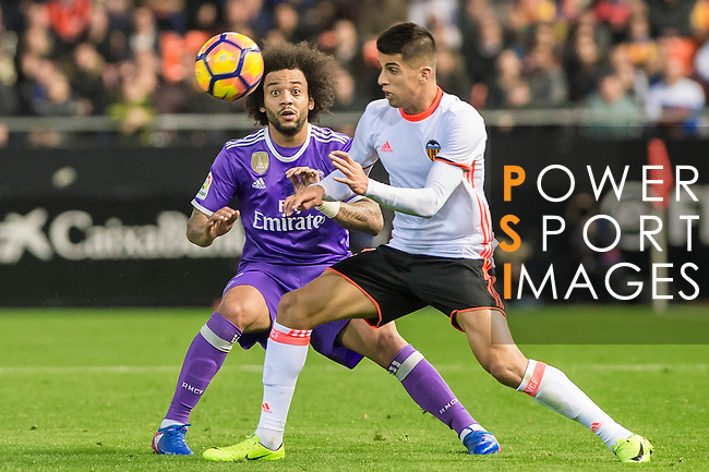 Joao Cancelo (r) of Valencia CF battles for the ball with Marcelo Vieira Da Silva of Real Madrid during their La Liga match between Valencia CF and Real Madrid at the Estadio de Mestalla on 22 February 2017 in Valencia, Spain. Photo by Maria Jose Segovia Carmona / Power Sport Images
