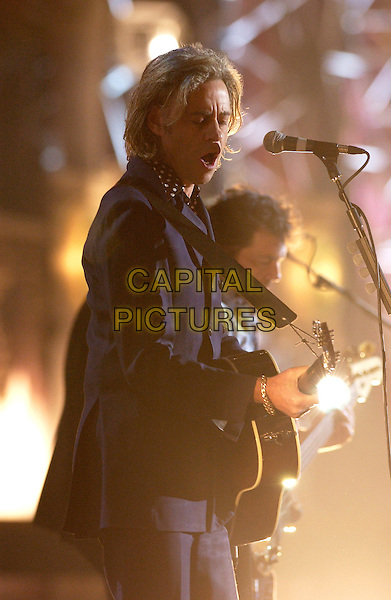 BOB GELDOF.Brit Awards 2005 - Live Performance.Earls Court 2, London, SW5.half length, stage, concert, show, music, live gig blue suit jacket singing guitar.www.capitalpictures.com.sales@capitalpictures.com.©Capital Pictures