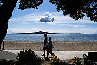 1st April 2020, Kohi Beach, Auckland, New Zealand; A couple walking at Kohi Beach during the lockdown due to Covid-19. Kohimarama, Auckland, New Zealand on Wednesday 1 April 2020.