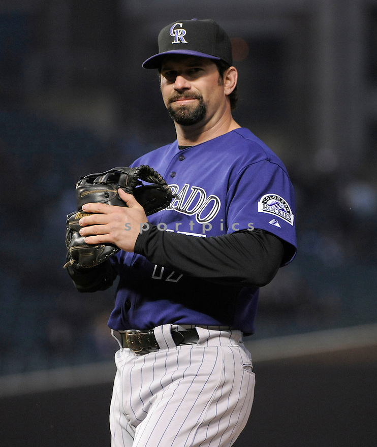 TODD HELTON, of the Colorado Rockies, in action during the Rockies game against the Chicago Cubs, on April 25, 2011 at Wrigley Field in Chicago, Illinois.  The Rockies beat the Cubs 5-3.