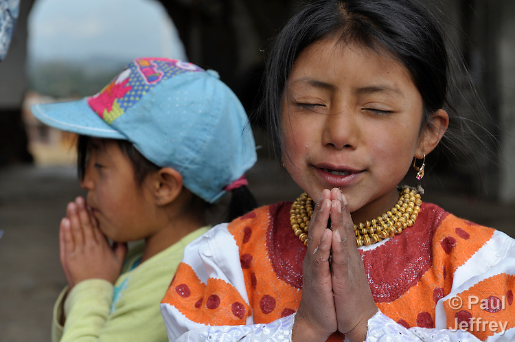 Indigenous children who live on the contested Hacienda El Prado, near Cayambe, Ecuador, pray during an activity led by a United Methodist missionary.