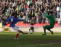 Ryan Hardie shoots to score past Jordan Hart in the Celtic v Rangers City of Glasgow Cup Final match played at Firhill Stadium, Glasgow on 29.4.13,  organised by the Glasgow Football Association and sponsored by City Refrigeration Holdings Ltd.