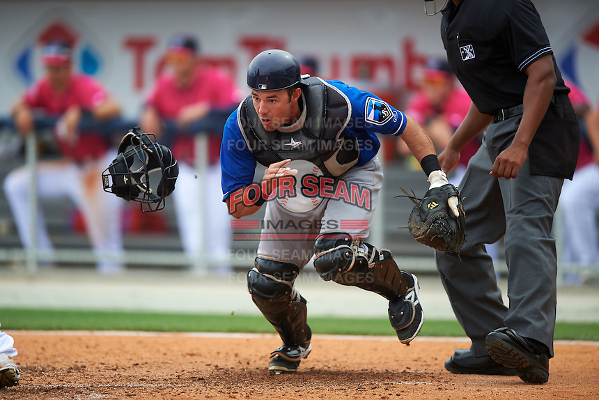 Biloxi Shuckers catcher Adam Weisenburger (8) retrieves the ball after blocking a pitch during the first game of a double header against the Pensacola Blue Wahoos on April 26, 2015 at Pensacola Bayfront Stadium in Pensacola, Florida.  Biloxi defeated Pensacola 2-1.  (Mike Janes/Four Seam Images)