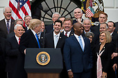 United States President Donald J. Trump turns to a laughing group of Republican lawmakers including: United States Vice President Mike Pence, far left, Speaker of The House of Representatives  Paul Ryan, Republican of Wisconsin, center, United States Senator Tim Scott, Republican of South Carolina, center right, and Representative Diane Black, Republican of Tennessee, right, during an event on the South Lawn of the White House after the United States Congress passed the Republican sponsored tax reform bill, the 'Tax Cuts and Jobs Act' in Washington, D.C. on December 20th, 2017. Credit: Alex Edelman / CNP
