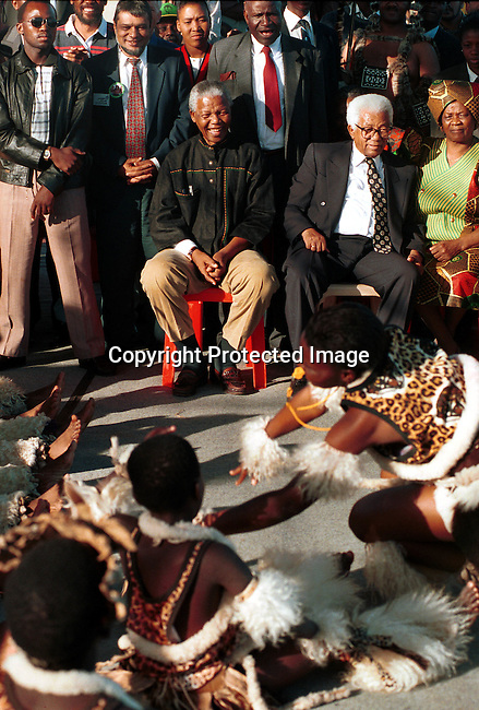 dipeman00467 .President Nelson Mandela and the late Walter Sisulu enjoying a youth group singing and dancing a traditional theme at an ANC rally in Durban, weeks before the first democratic election in 1994. .©Per-Anders Pettersson/iAfrika Photos