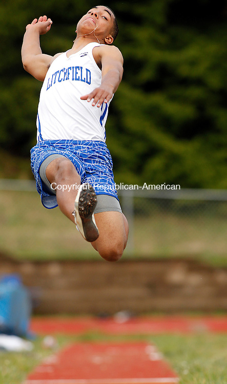 Woodbury, CT-01 May 2012-050112CM09-  Litchfield's  Darren Crowder sails through the air in the long jump during a track meet Tuesday afternoon at Nonnewaug High School in Woodbury.  The Chiefs welcomed Litchfield and Wamogo to the Berkshire matchup.   Christopher Massa Republican-American