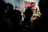 An auctioneer sells ceramic and porcelain figures at the Fuzi Miao tourist area in Nanjing, Jiangsu, China.