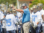 Corona Del Mar, CA 04/02/16 - Corona Del Mar Coach G.W. Mix and team during a time out in the second quarter of their game against visiting Torrey Pines.