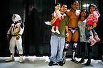 Lucha Libre AAA wrestlers Mascarita Sagrada, left, and El Mesias pose with fans in Sacramento, CA March 28, 2009.
