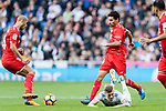 Toni Kroos of Real Madrid gets tripped as he fights for the ball with Jesus Navas Gonzalez of Sevilla FC during the La Liga 2017-18 match between Real Madrid and Sevilla FC at Santiago Bernabeu Stadium on 09 December 2017 in Madrid, Spain. Photo by Diego Souto / Power Sport Images