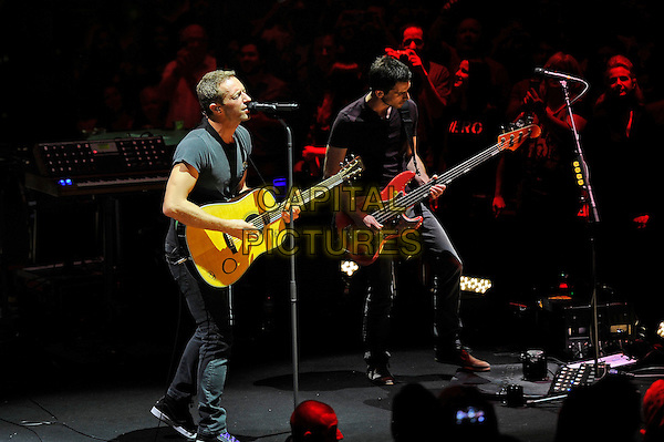 LONDON, ENGLAND - July 1: Chris Martin and Guy Berryman of 'Coldplay' performing at Royal Albert Hall on July 1, 2014 in London, England.<br /> CAP/MAR<br /> &copy; Martin Harris/Capital Pictures